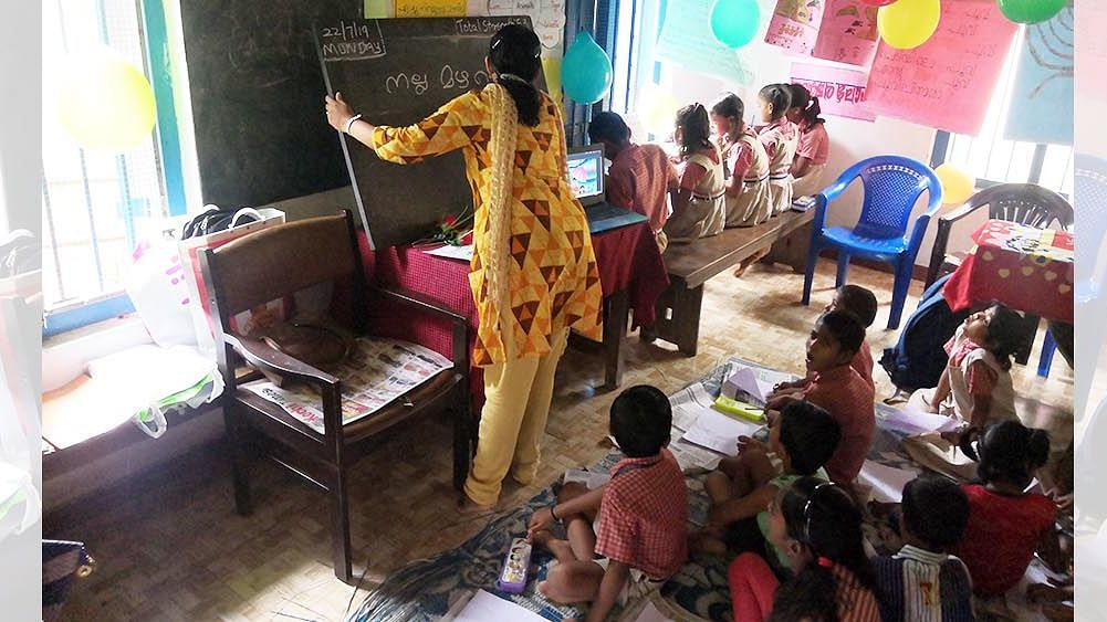 Children learn Malayalam as part of Roshini, a program to help children of migrant workers in Ernakulam learn Malayalam in government and government-aided schools, through the use of multiple languages, including their mother tongue.