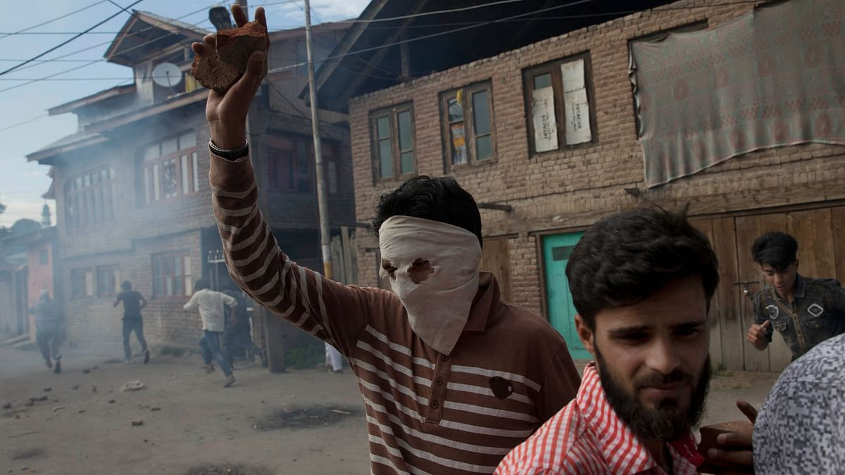 Kashmiri youth clashed with Indian policemen on Srinagar's outskirts on 23 August.
