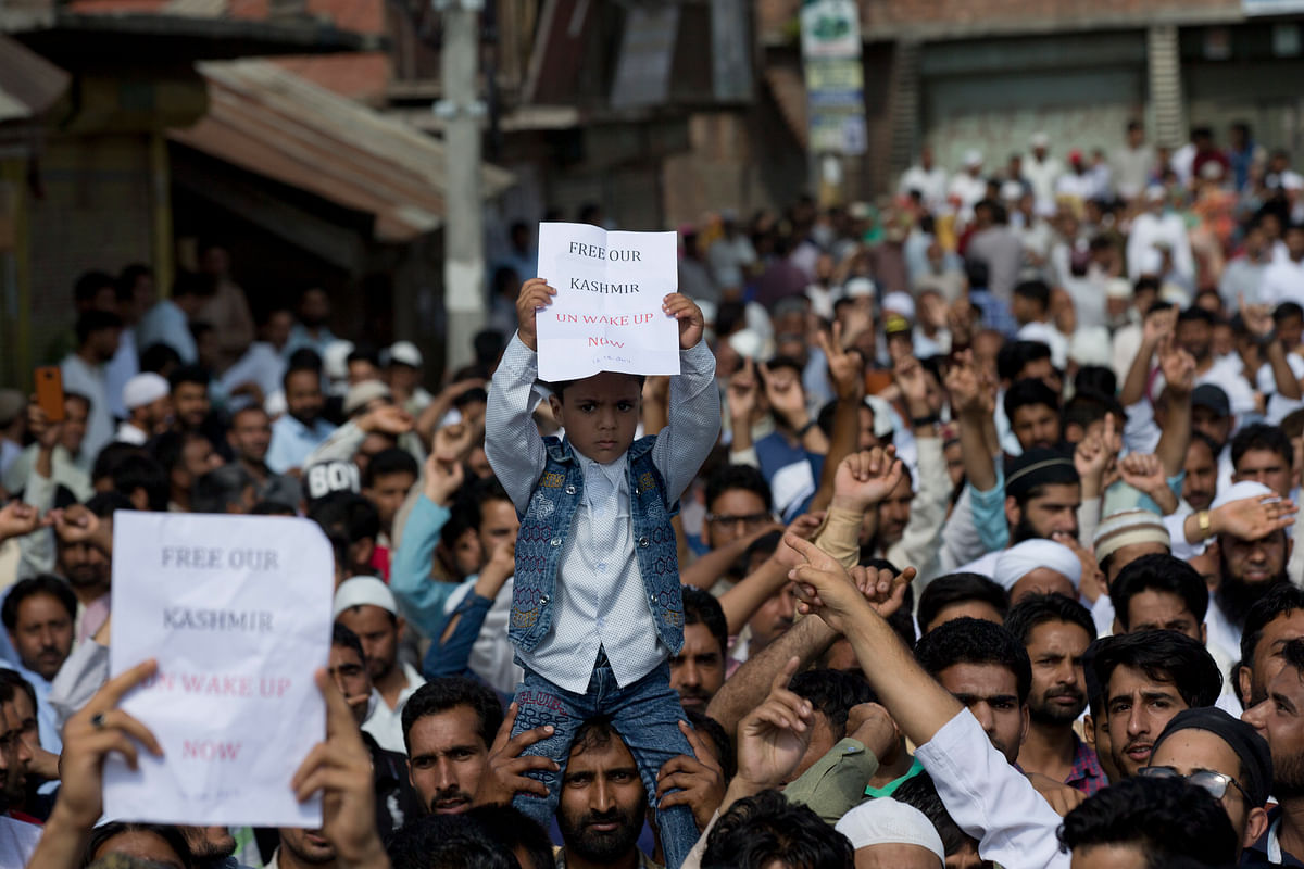A child holds a placard during a protest in Srinagar.