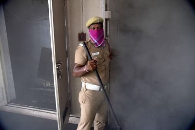 Chennai: A police personnel at the Harbour Telephone Exchange of the Bharat Sanchar Nigam Ltd (BSNL) where a fire broke out affecting mobile, landline and broadband connectivity in the area, in Chennai on Aug 1, 2019. (Photo: IANS)
