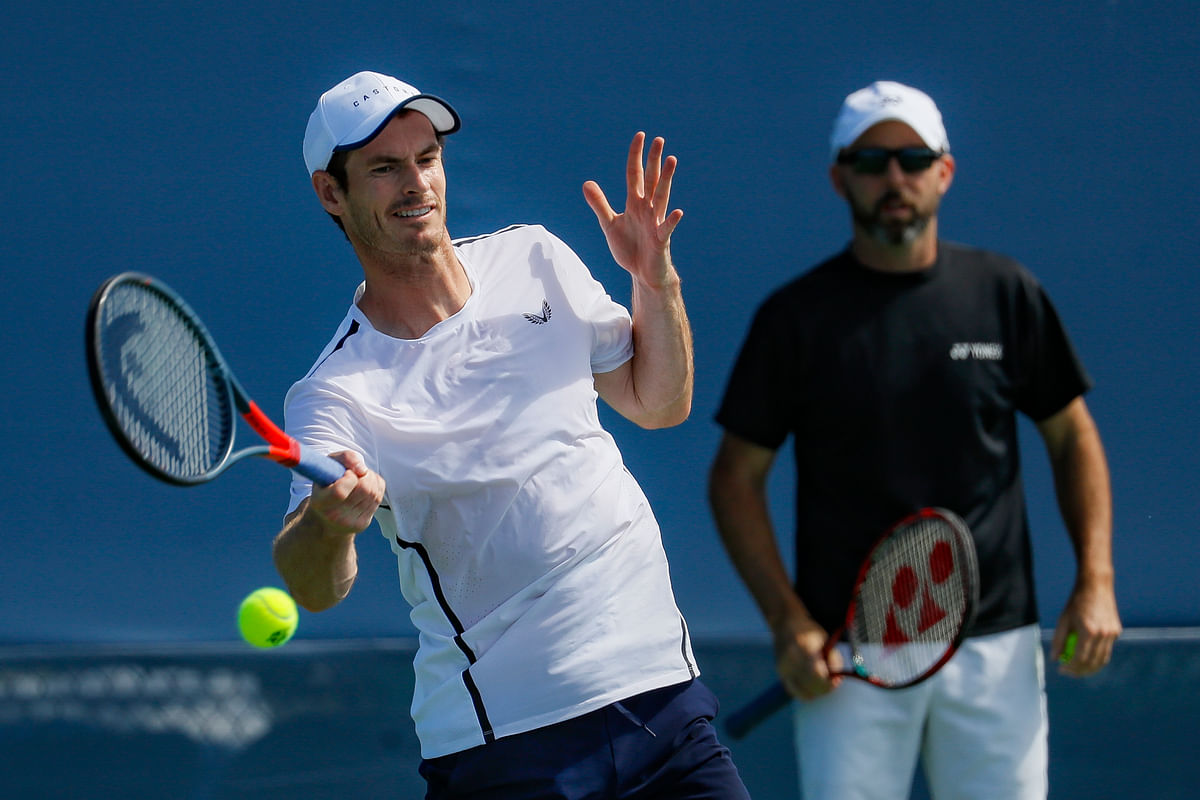 Andy Murray practices as his coach Jamie Delgado, right, at the Western & Southern Open tennis tournament, Sunday, Sunday, Aug. 11, 2019, in Mason, Ohio.