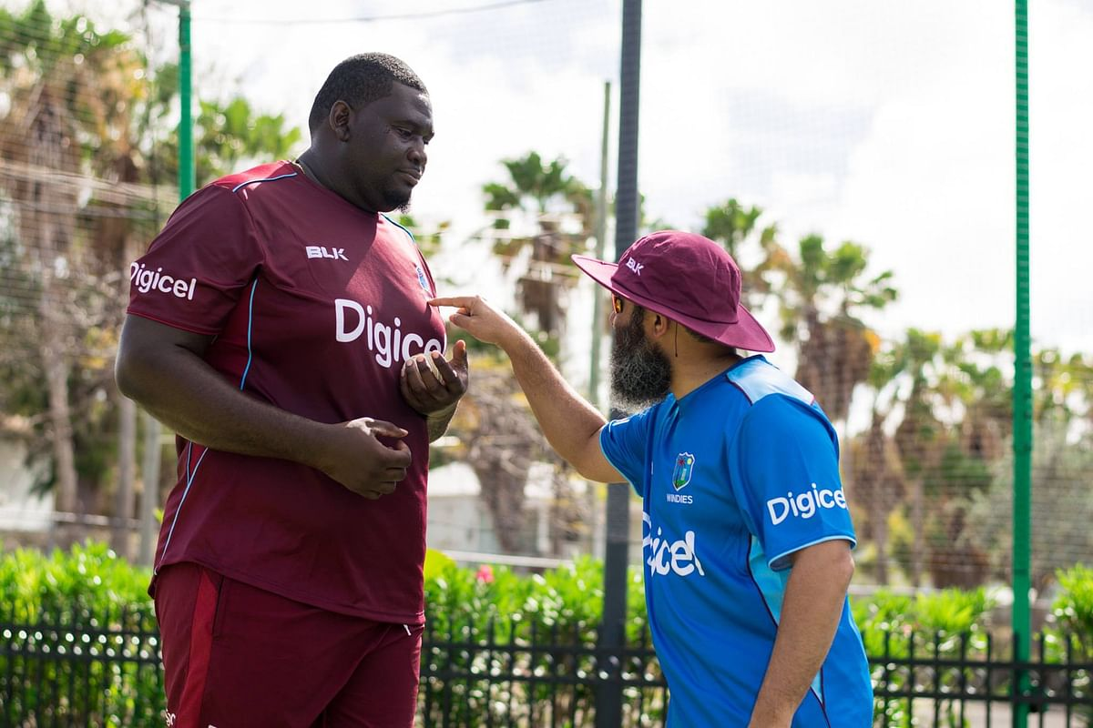 West Indies' Rahkeem Cornwall with former Pakistan cricketer Mushtaq Ahmed
