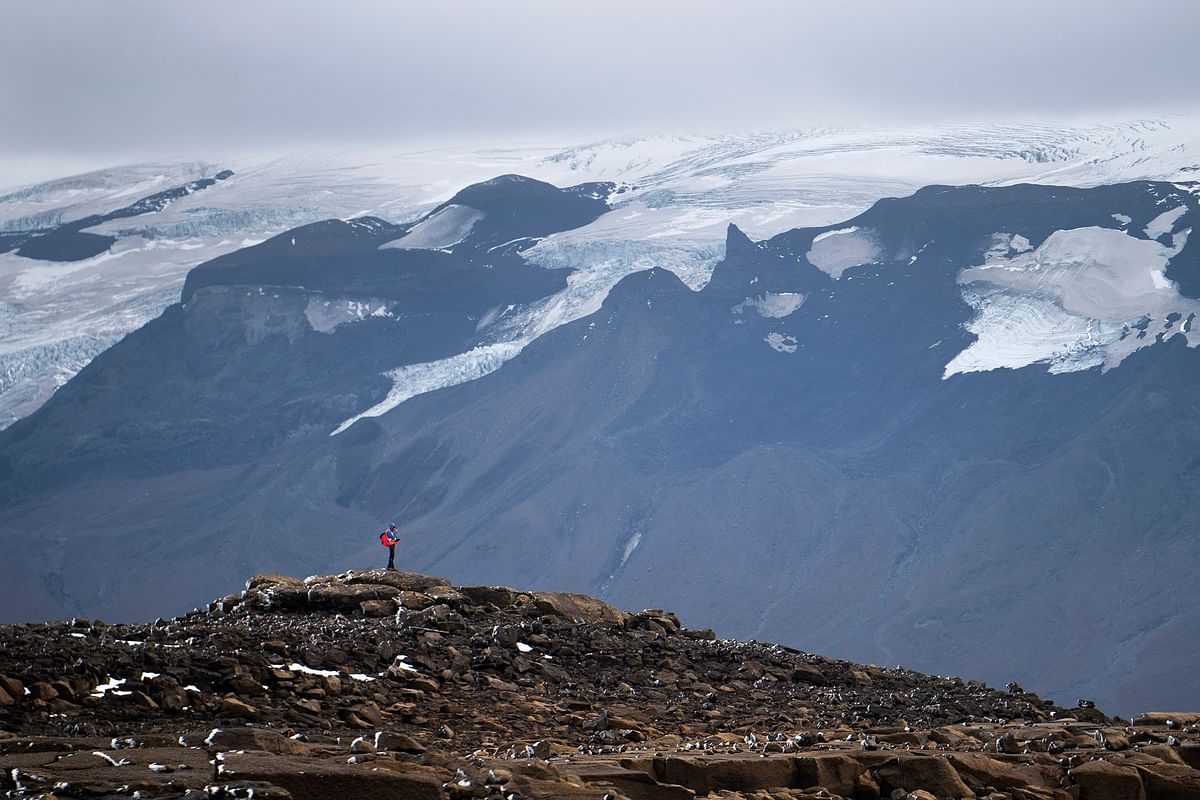 A man stops on his way to the top of what once was the Okjokull glacier, in Iceland, Sunday,18 August 2019.