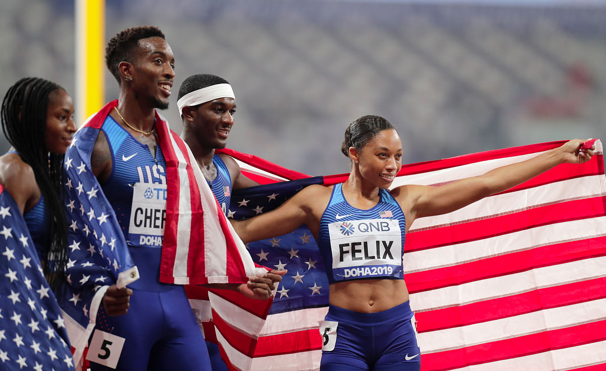 The United States team of Allyson Felix, Wilbert London, Michael Cherry and Courtney Okolo after winning the gold medal in the mixed 4x400 meter relay race at the World Athletics Championships.