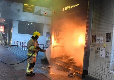 HONG KONG, Sept. 15, 2019 (Xinhua) -- A firefighter tries to put out a fire at the mass transit railway (MTR) Wan Chai station in Hong Kong, south China, Sept. 15, 2019. Rioters set fires in Central and Admiralty areas, threw petrol bombs at the Hong Kong Special Administrative Region (HKSAR) government offices and vandalized mass transit railway (MTR) stations Sunday. (Xinhua/IANS)