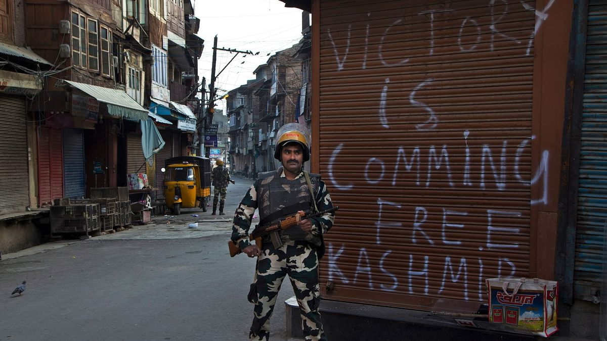 An Indian paramilitary soldier stands guard during curfew enforced to quell protestors in Srinagar.