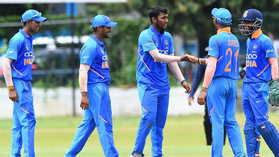 Atharva Ankolekar (centre) finished with figures of 5 for 28 from 8 overs.