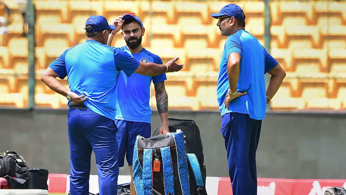 Indian captain Virat Kohli with head coach Ravi Shastri and bowling coach Bharat Arun during a training session.