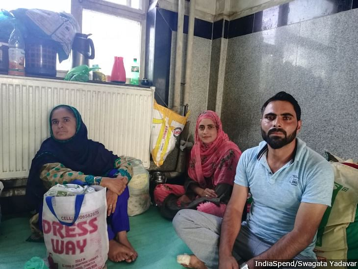 Abdul Qayoom and his wife Shaista sit with a relative in the waiting room of Lal Ded