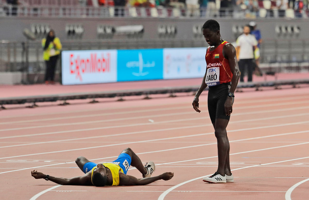 Aruba's Jonathan Busby leaves in a wheelchair after a men's 5000m heat at the World Athletics Championships in Doha, Qatar, Friday, Sept. 27, 2019.