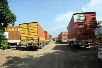 Gurugram: Slowdown Pain: Trucks stranded in Gurugram due to want of work, as demand from auto industry recede on the back of a sales slowdown. (Photo: Bidesh Manna/IANS)