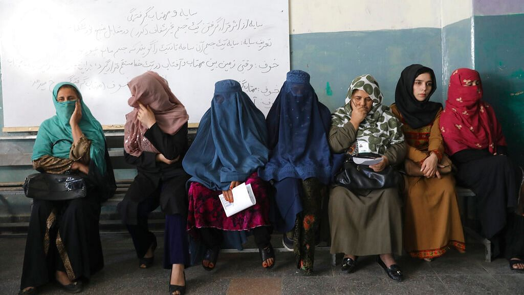 Afghan women wait for the a polling station to open in Kabul, Afghanistan on Saturday, 28 September 2019.