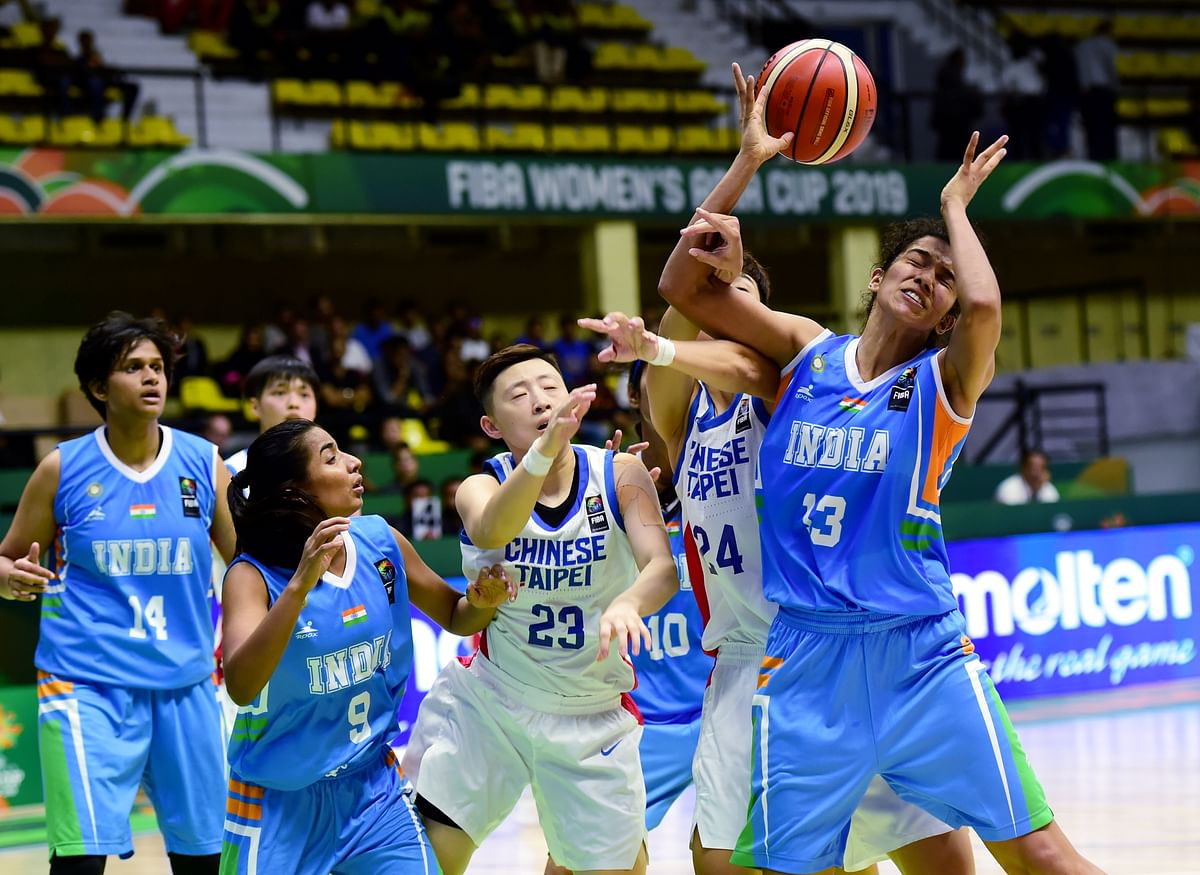 India's Jeena Skaria and Chinese Taipeis Szu Chin Peng in action during the FIBA Womens Asia Cup 2019 league match at Kanteerava Stadium in Bengaluru, Thursday, 26 September.