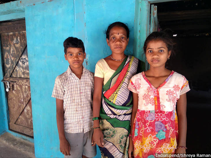 Pushpa Kadale, 32, with her daughter, 14, and son, 12. Kadale, a farmer from Gawandh village in Nashik district of Maharashtra, was abandoned by her husband 12 years ago.