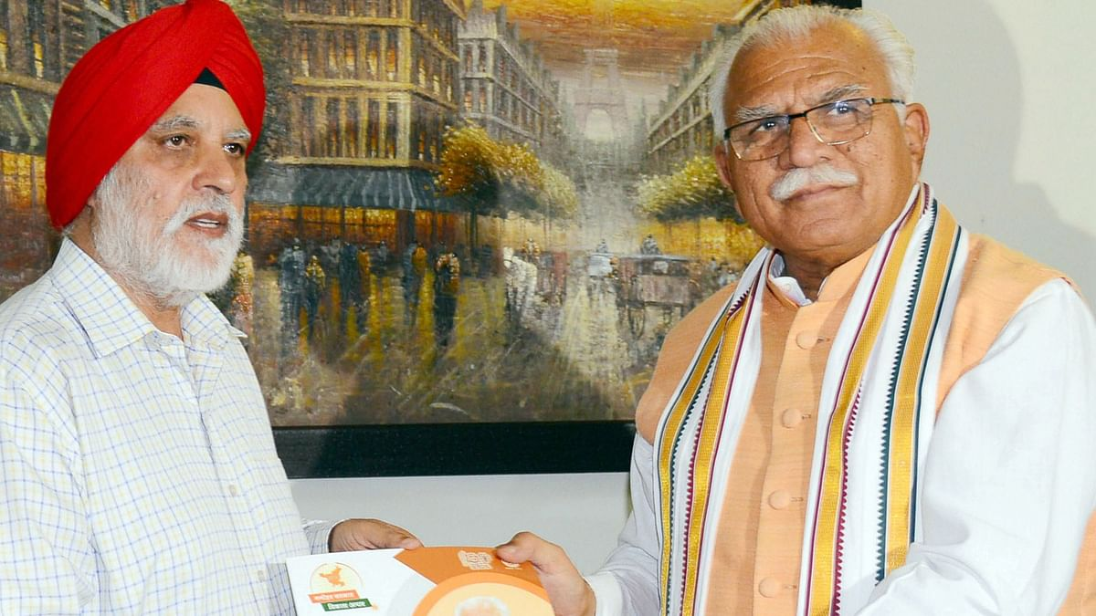Haryana Chief Minister Manohar Lal with Justice (Retd) HS Bhalla.