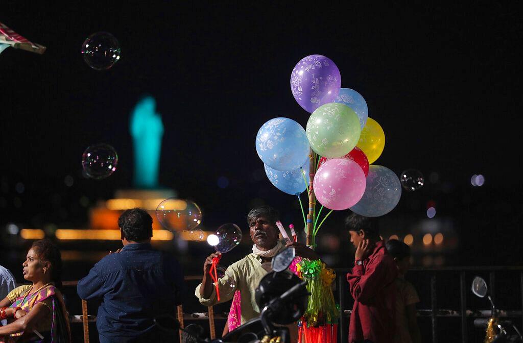 An Indian vendor sells balloons near the Hussain sagar lake in Hyderabad, Telangana.