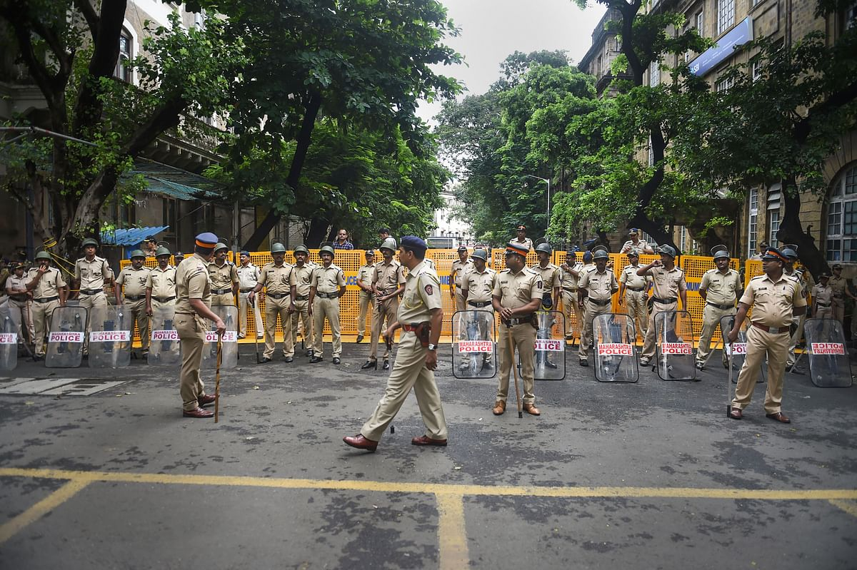 Police protection outside ED office during NCP party workers protest, to condemn the registration of a money laundering case against party chief Sharad Pawar in connection with the Maharashtra State Cooperative Bank (MSCB) scam, in Mumbai.