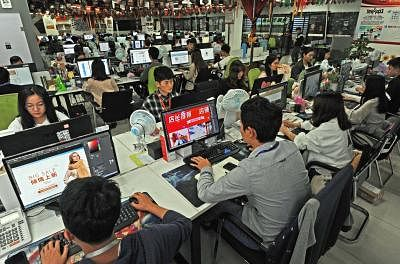 BEIJING, May 7, 2019 (Xinhua) -- Staff members work at an e-commerce service company in Yiwu, east China