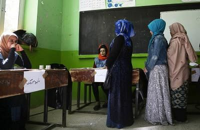 KABUL, Oct. 20, 2018 (Xinhua) -- Afghan voters wait to cast their ballots at a polling center during parliamentary elections in Kabul, Afghanistan, Oct. 20, 2018. Millions of Afghan voters cast their ballots on Saturday for long-delayed parliamentary elections in the militancy-plagued country amid reports of security threats and irregularities. (Xinhua/Rahmat Alizadah/IANS)