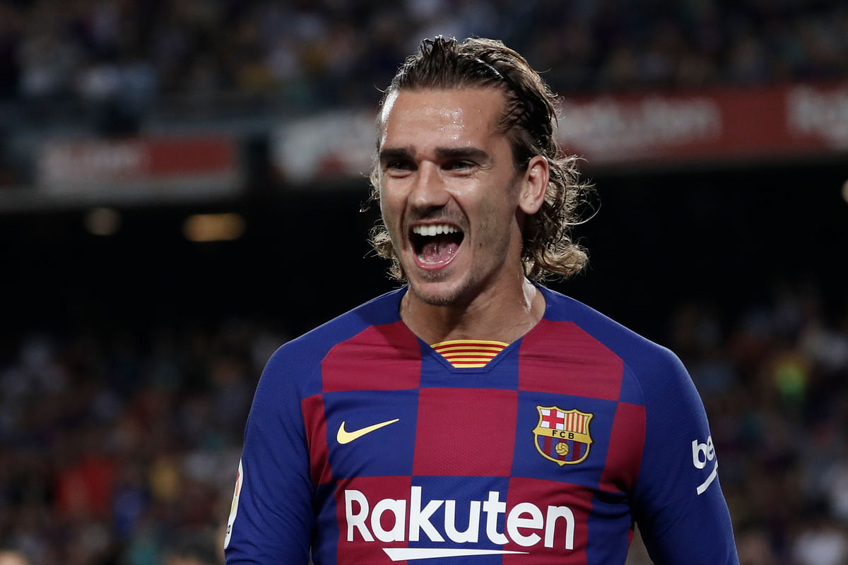 Barcelona's Antoine Griezmann celebrates after scoring the opening goal during the Spanish La Liga soccer match between FC Barcelona and Villarreal CF at the Camp Nou stadium in Barcelona, Spain, Tuesday, Sep. 24, 2019.