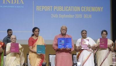 New Delhi: Union Finance and Corporate Affairs Minister Nirmala Sitharaman and Rashtriya Swayamsevak Sangh (RSS) chief Mohan Bhagwat unveil report on Status of Women in India, in New Delhi on Sep 24, 2019. (Photo: IANS)