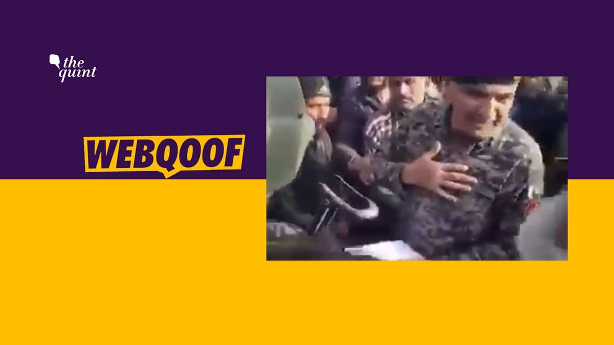 Pakistani Army personnel is seen handing out envelopes of money to people, which they claim contain a sum of (Pakistani) Rs 1000.