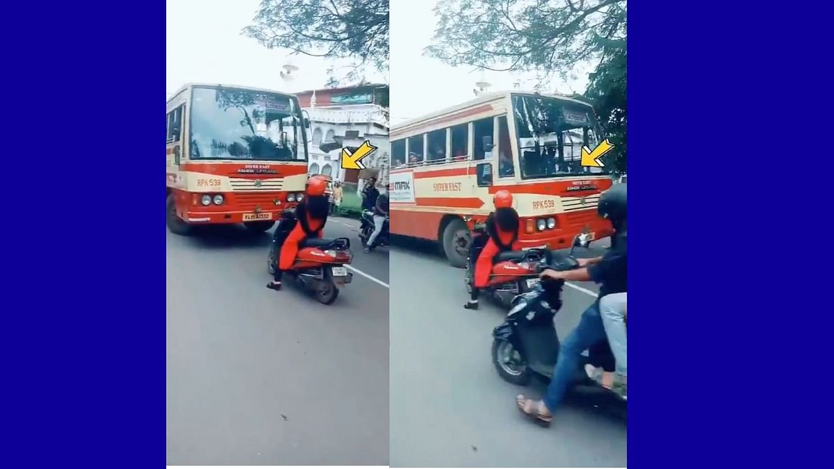 Instead of skirting around the bus, the woman is seen waiting till the bus changes the lane to the right one.