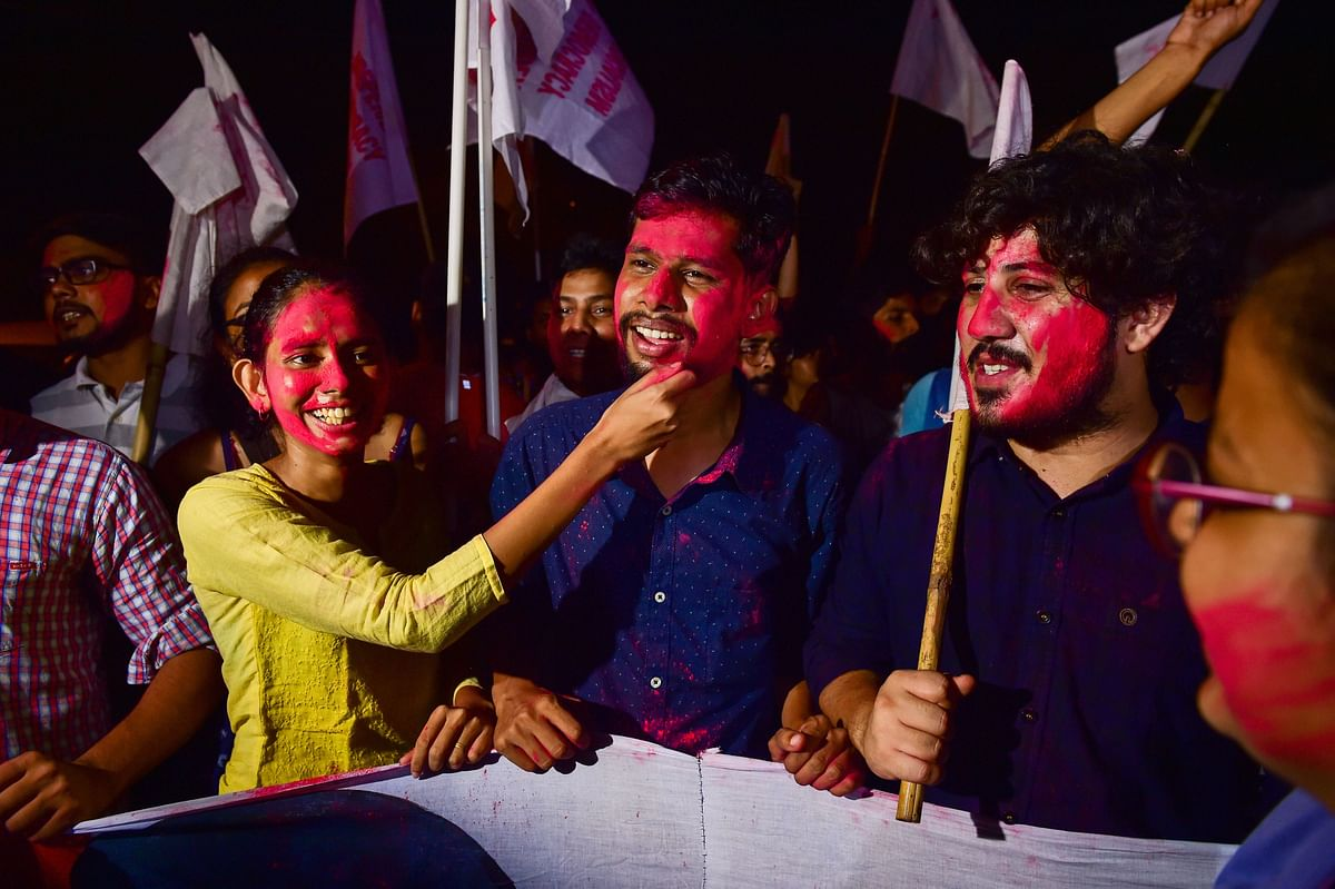 Newly-elected JNUSU President Aishe Ghosh (L), Vice-President Saket Moon (C) and others celebrate after Delhi High Court declared results of Jawaharlal Nehru University Students Union (JNUSU) polls, at JNU Campus in New Delhi.