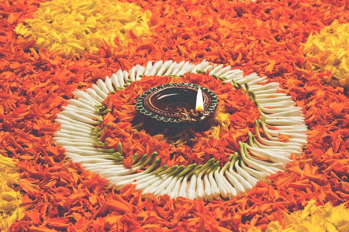 Make rangoli using flower petals.