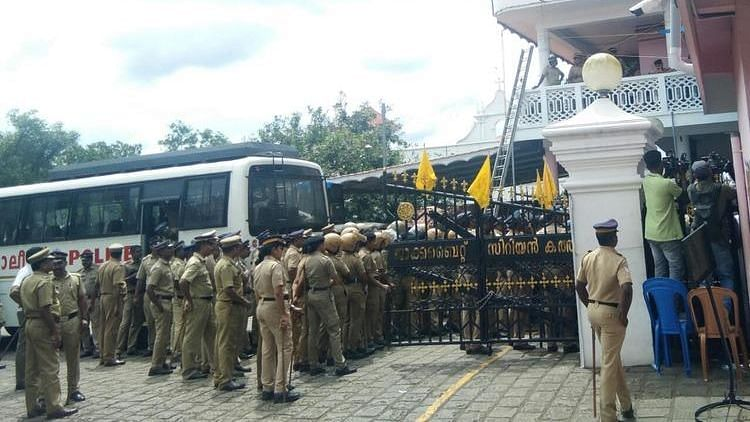 Dramatic scenes played out at the historic St Mary's Church in Piravom in Ernakulam as the Kerala police tried to open the gate of the church to allow the Orthodox faction to enter.