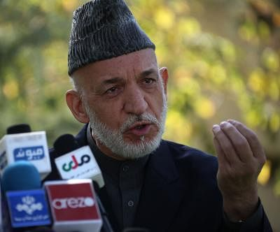 KABUL, Oct. 12 (Xinhua) -- Former Afghan president Hamid Karzai speaks during a press conference in Kabul, capital of Afghanistan, Oct. 12, 2017. Former Afghan President Hamid Karzai on Thursday slammed U.S. new strategy on Afghanistan as warmongering and called on the Afghan government to convene the traditional Loya Jirga or grand assembly of elders and chieftains to find solution for his country