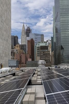 Gandhi Solar Park on the roof of a building in the United Nations headquarters in New York with a view of the city