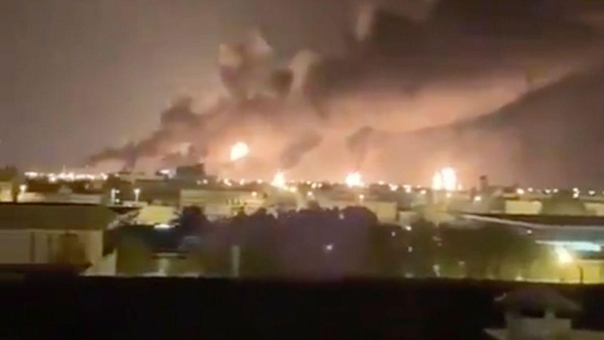 Smoke fills the sky at the Abqaiq oil processing facility on Saturday,  in Saudi Arabia.