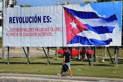 HAVANA, Jan. 2, 2019 (Xinhua) -- A man walks past a billboard on a street in Havana, Cuba, Dec. 29, 2018. TO GO WITH Feature: Cuba marks 60th anniversary of revolution, continuing on socialist path (Xinhua/Joaquin Hernandez/IANS)