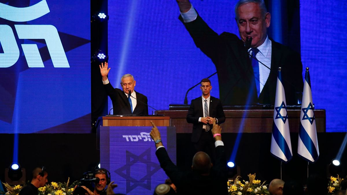 Israeli Prime Minister Benjamin Netanyahu addressees his supporters at party headquarters after elections in Tel Aviv on 18 September.