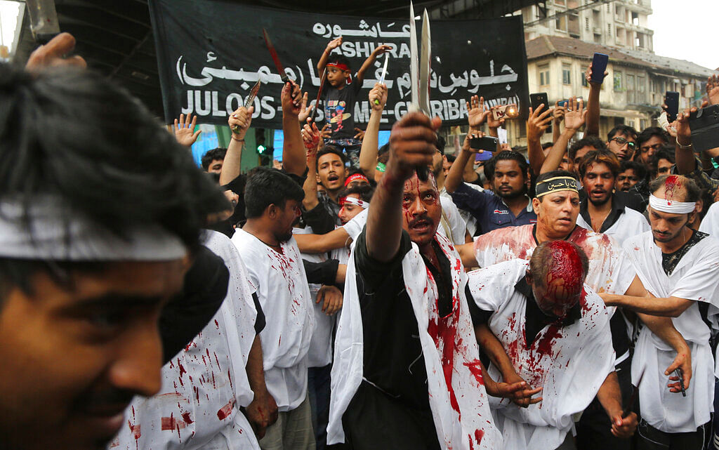 Indian Shiite Muslims flagellate themselves during a procession to mark Ashoura in Mumbai. Ashoura falls on the 10th day of Muharram, the first month of the Islamic calendar, when Shiites mark the death of Hussein, the grandson of the Prophet Muhammad, at the Battle of Karbala in present-day Iraq in the 7th century.