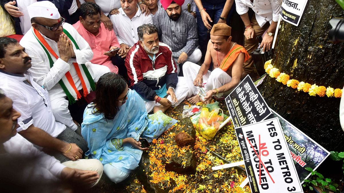 Mumbai Congress workers along with save Aarey activists and local residents participate in a programme organised to protest against the cutting of 2,700 trees.
