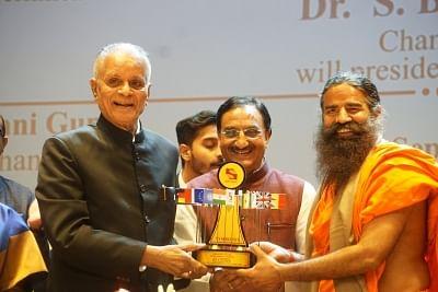 Noida: Yoga Guru Baba Ramdev being felicitated by Symbiosis International University Chancellor S. B. Mujumdar during the inauguration of the University