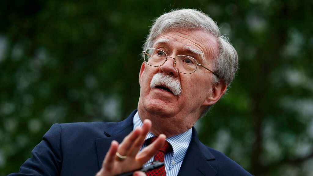 In this 1 May 2019 file photo, John Bolton talks to reporters outside the White House in Washington.