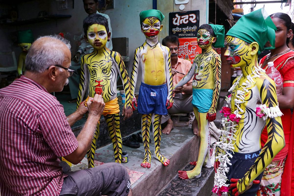 An artist paints young devotees ahead of Muharram festival, in Nagpur, Monday, 9 September. Muharram is the first month of the Islamic calendar and is considered as one of the sacred months of the year.
