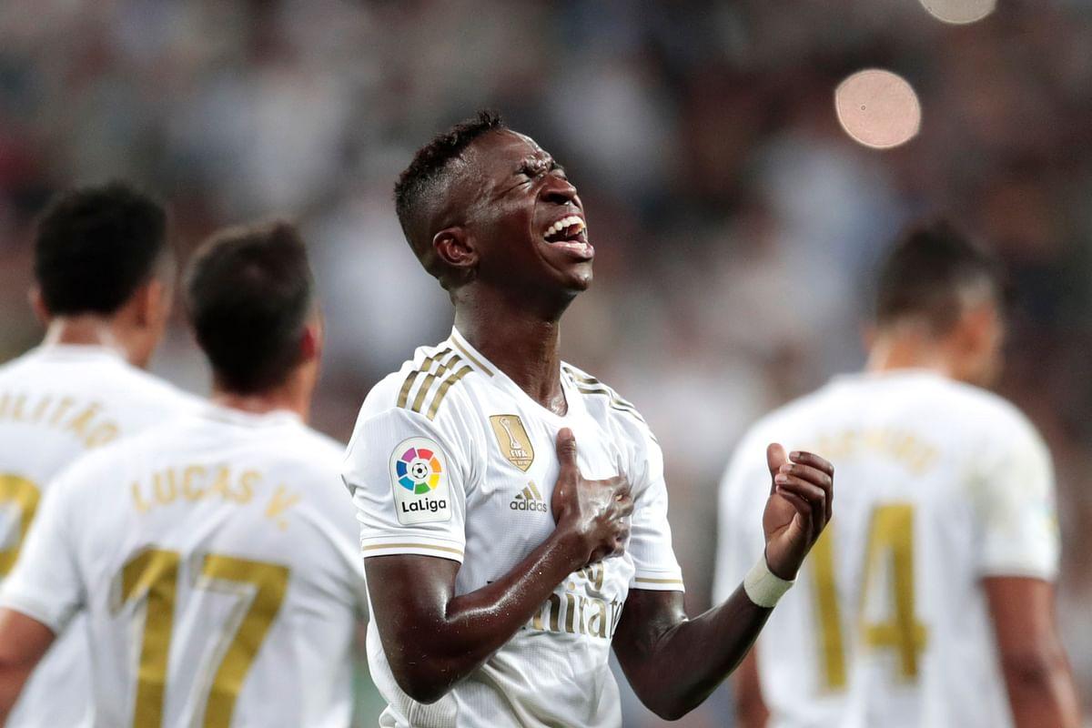 Real Madrid's Vinicius Jr. celebrates scoring the opening goal during the Spanish La Liga soccer match between Real Madrid and Osasuna at the Santiago Bernabeu.