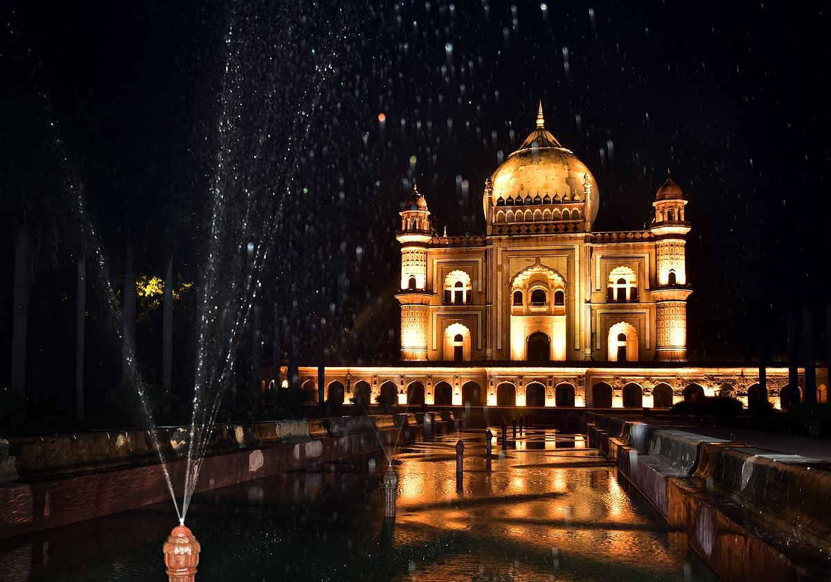 A view of the illuminated Safdarjung Tomb  with its newly built fountain, in New Delhi.