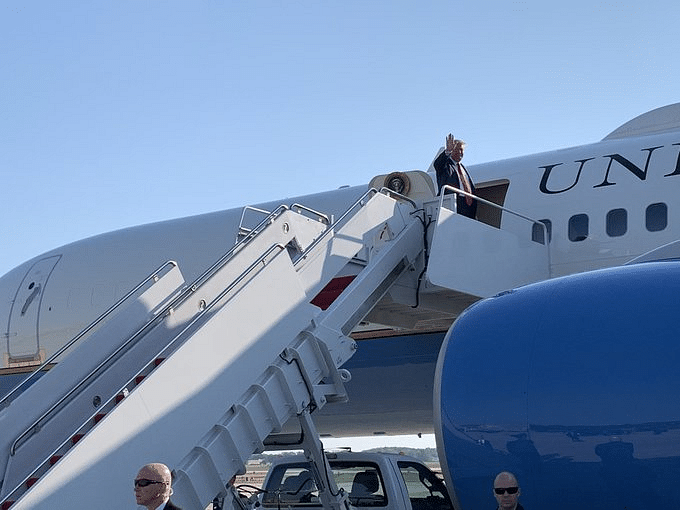 Donald Trump embarks on the Air Force One for a flight to Houston.