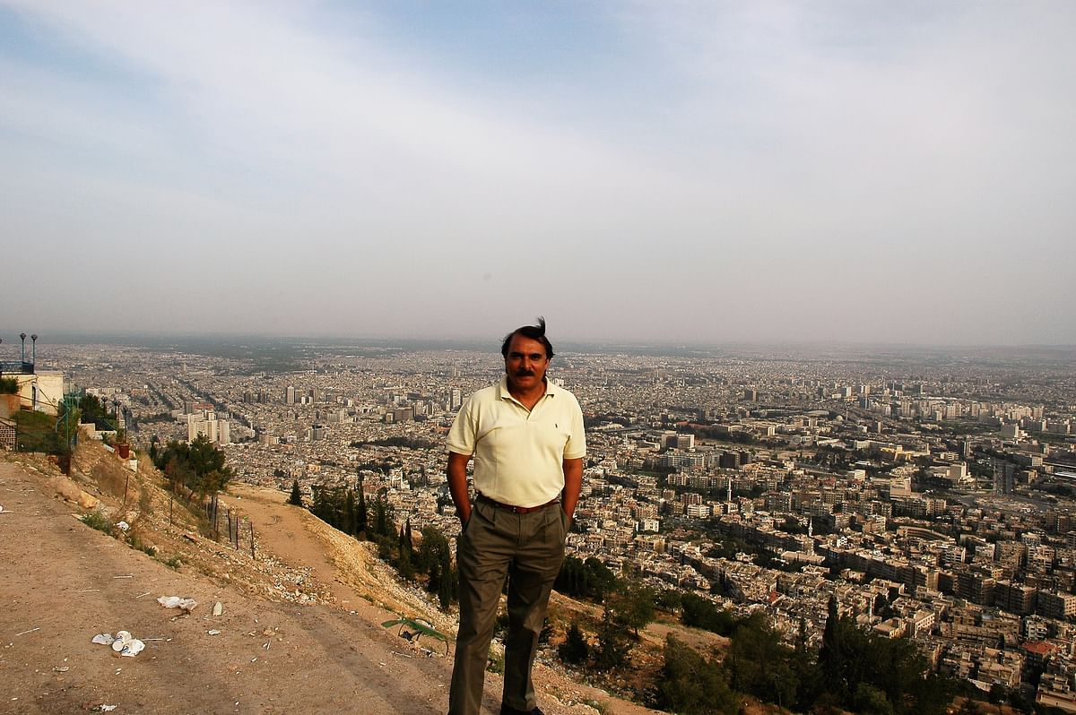 The author on a hilltop above the urban sprawl of Damascus. It is said that Prophet Mohammed, looking upon the city, refused to enter it because he wanted to see paradise only once – upon his death.