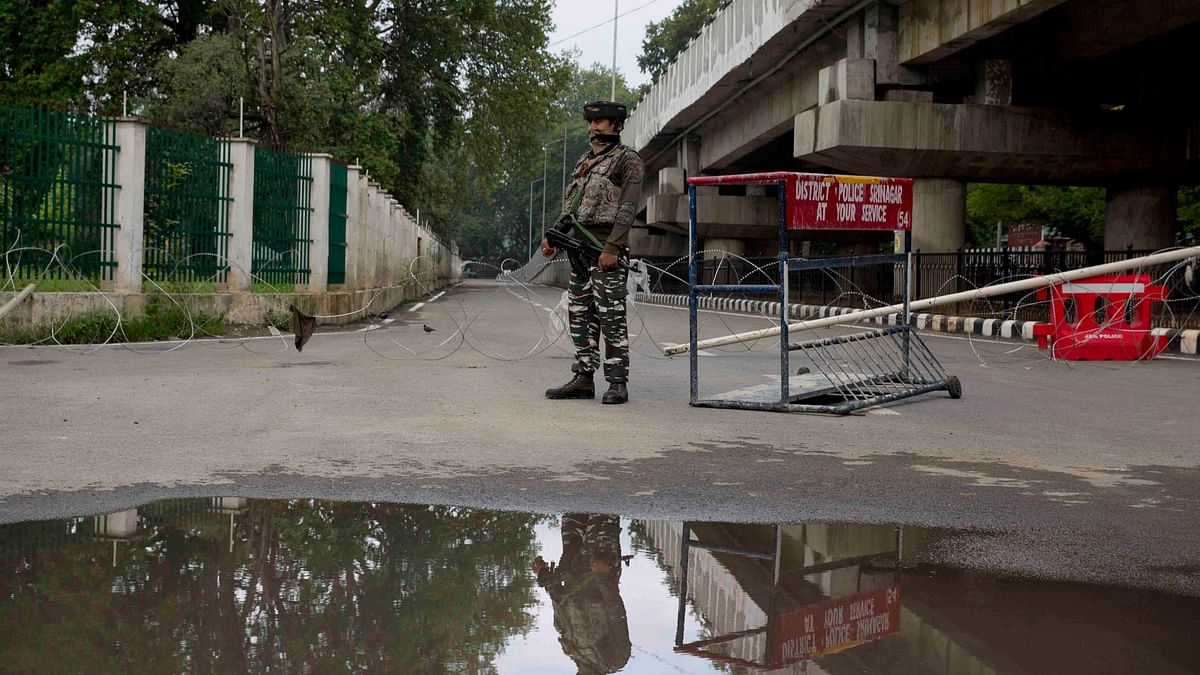 An Indian paramilitary soldier stands guard near a temporary checkpoint on the road leading towards the Independence Day parade venue during lockdown in Srinagar. Image used for representational purposes.