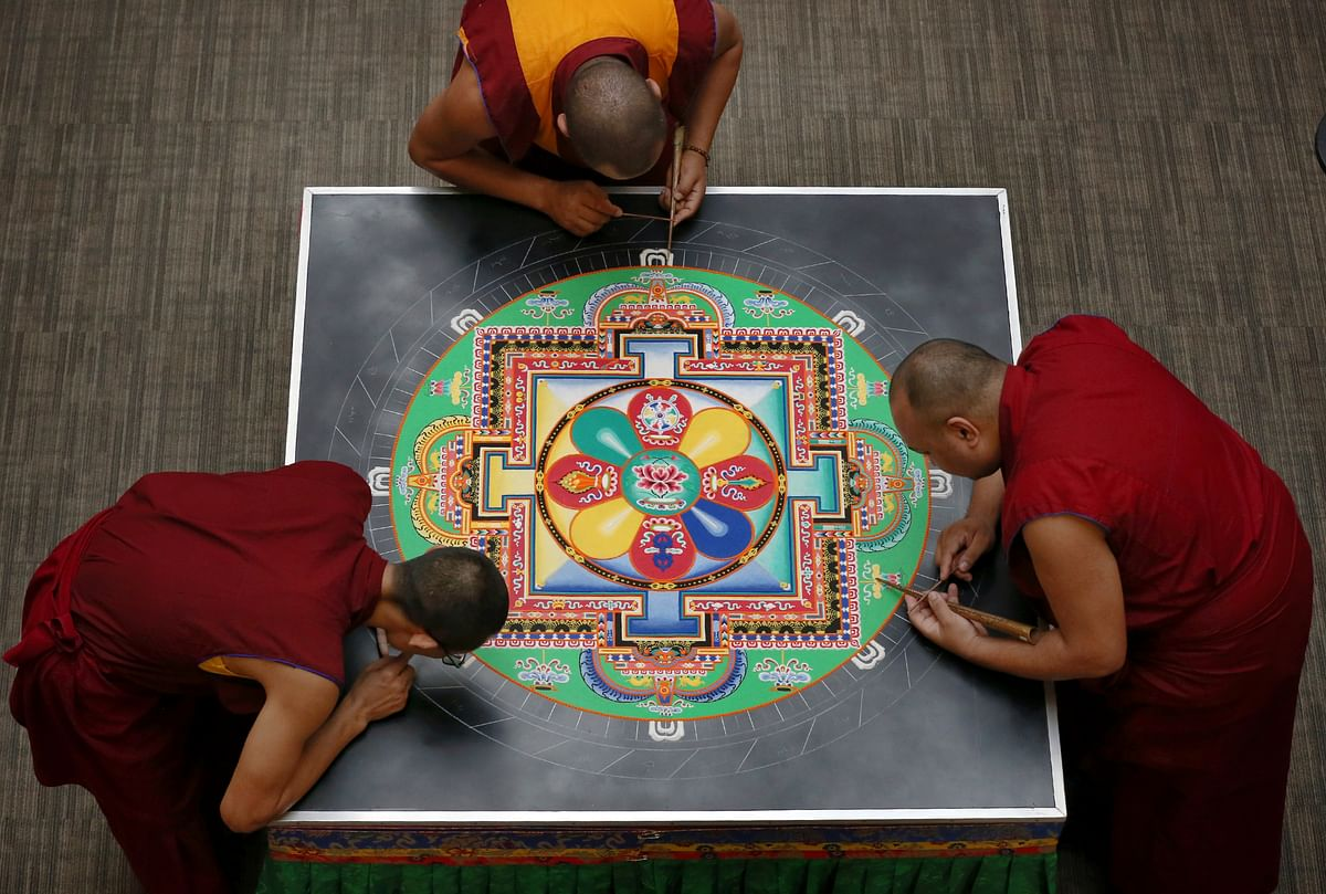 Tibetan Buddhist monks from the Drepung Loseling Monastery in southern India create a sand mandala in the atrium of the Colket Center at Roanoke College in Salem on Thursday, 26 September, 2019.
