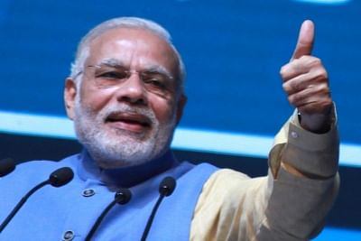 Modi hails FM, says corporate tax cut to attract investment