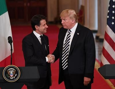 WASHINGTON, July 30, 2018 (Xinhua) -- U.S. President Donald Trump (R) shakes hands with Italian Prime Minister Giuseppe Conte during a joint press conference at the White House in Washington D.C., the United States, on July 30, 2018. U.S. President Donald Trump said during the press conference that he is ready to meet with Iranian President Hassan Rouhani without preconditions. (Xinhua/Liu Jie/IANS)