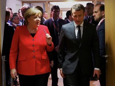 French President Emmanuel Macron (R, Front) and German Chancellor Angela Merkel (L). (Xinhua/European Union/IANS)