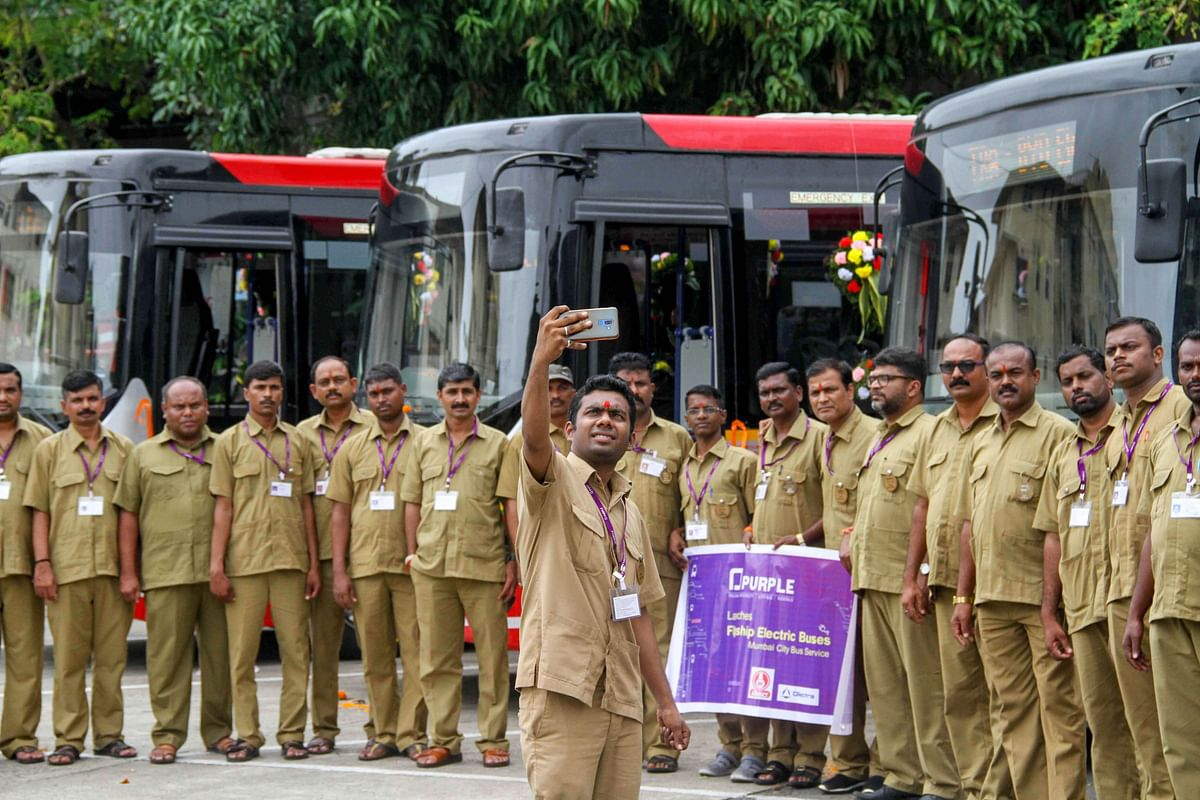 Drivers of Mumbai's first AC electric buses pose for a photograph after its launch, in Mumbai on Monday, 9 September. A total of six AC electric and four non-AC electric buses launched along with a new mobile app for bus tracking and other features.